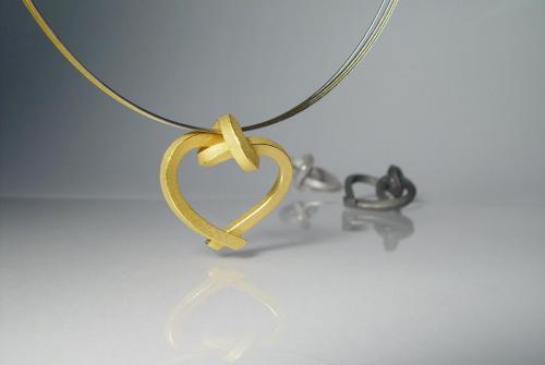 Herzschlaufe gelbgold -weißgold - platin